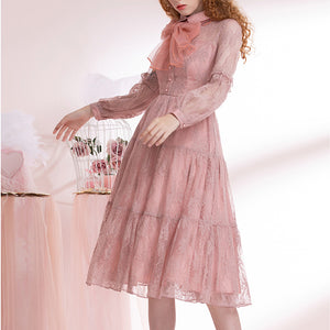 Ladies dress with lace long sleeves and bow ties