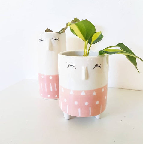 Adorable indoor pot on mini feet. The cute face of the coco pot, with a small nose and sweet eyelashes. Pink and White. Ceramic with no drainage hole.