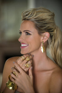 18 karat gold and diamond cocktail rings rings on smiling model's hands, making a bold statement.