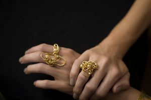 18 karat gold and diamond cocktail rings rings on model's hands, making a bold statement.