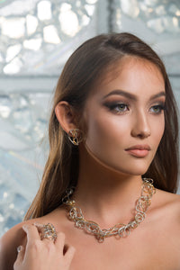 Model wearing silver and gold necklace | Nikki Sedacca Art Jewelry