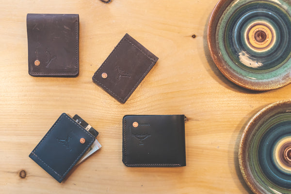 PlayHardLookDope Top Grain Wallet Collection on display in brown, ocean blue and black