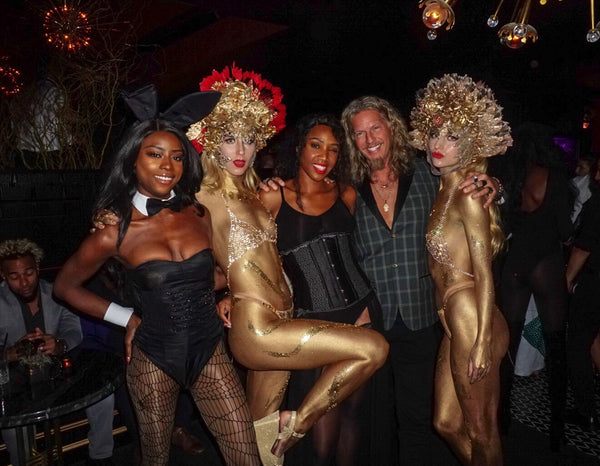 PlayHardLookDope poses with Playboy bunnies and ambiance performers at the Playboy Club NYC Masquerade party inside on Saturday October 27th
