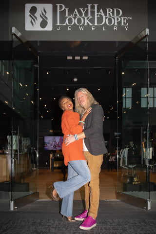PHLD Founders hugging each other in front of their new flagship location.