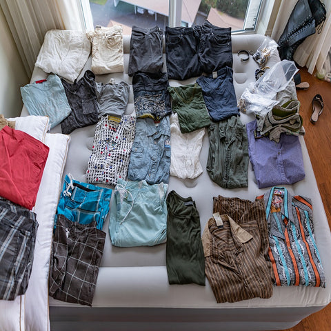 "<img src=""IMG-5869""alt=""clothes folded on blow up bed"">"