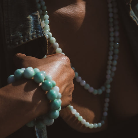 Woman wearing Jade necklace and bracelets
