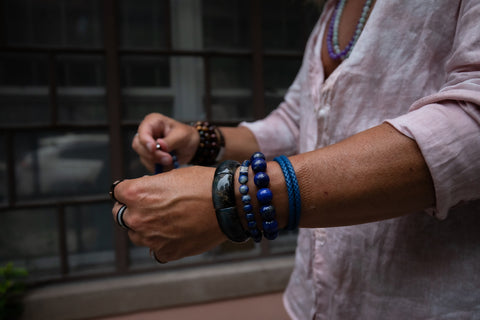 Male wearing Blue Bracelet Stack.