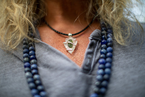 Man wearing Moldavite Necklace