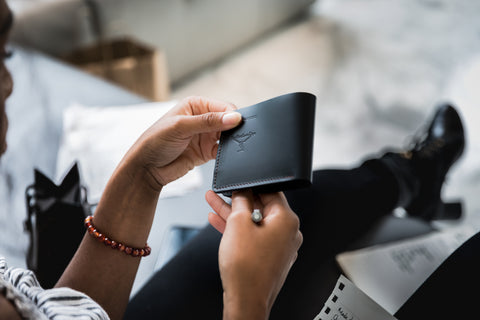 PlayHardLookDope Creative director Ebony Mackey displaying their black top grain leather wallet