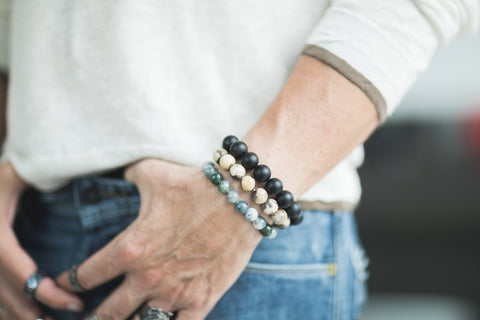 """</""Caucasian-male-wearing-three-natural-stone-bracelets""/>"