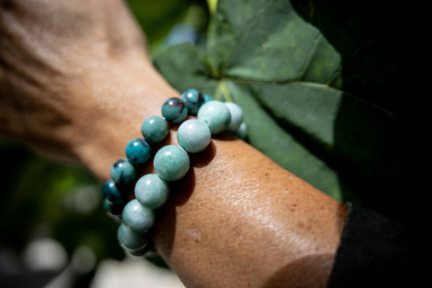 Male wearing Jade and Chrysocolla Gemstone Bracelets.