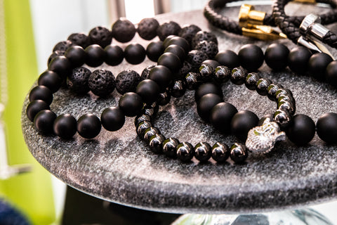 Buddha Natural Stone bracelets on display