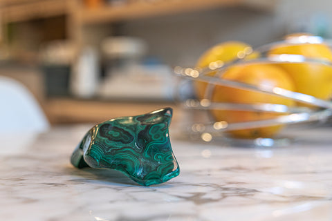 Malachite Gemstone Cluster sitting on Kitchen Table.