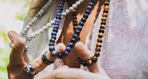 "<img src=""IMG_9866.JPG"" alt=""Male model wearing a pink linen shirt and three Natural Stone Necklaces- Tigers Eye, Sodalite and Howlite Stone"">"