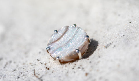 Drusy ring in the sand