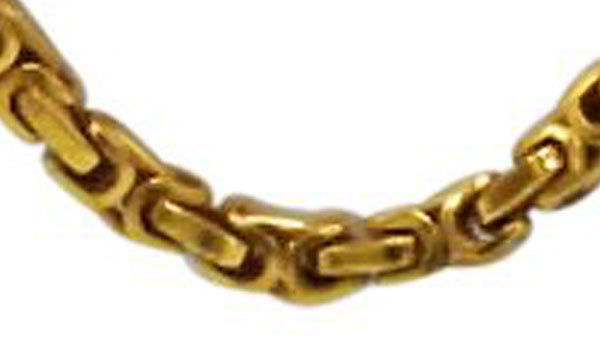 gold bike chain close up img
