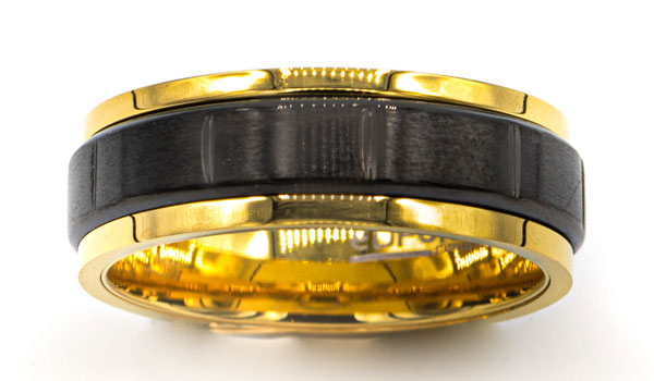 black and gold spinner ring close up