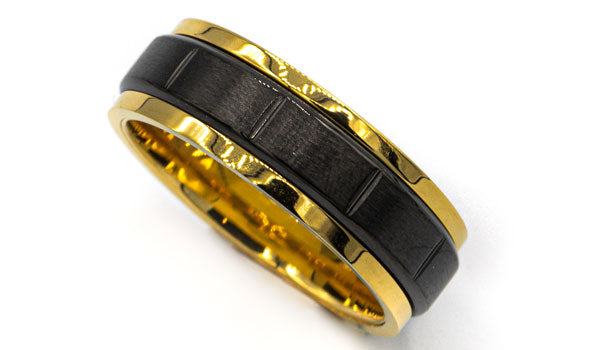 black and gold spinner ring