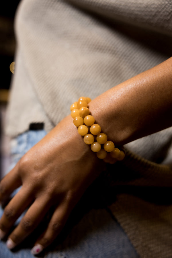 Woman wearing Yellow Jade Bracelet.