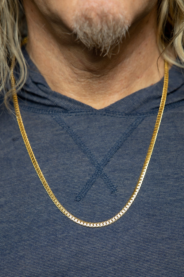 Man wearing Gold Herringbone Chain.