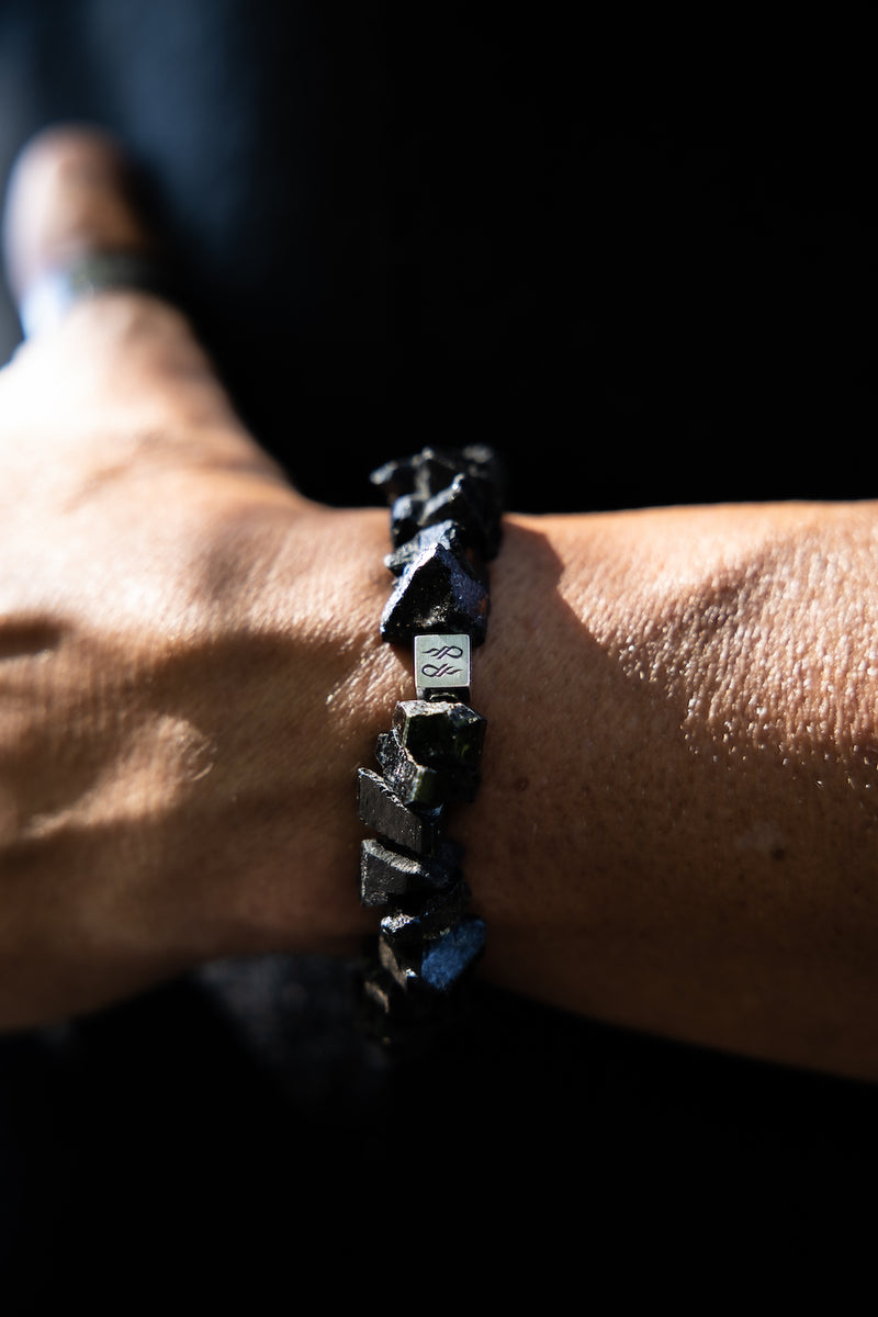 Alt= Male wearing Black tourmaline natural Gemstone Bracelet.