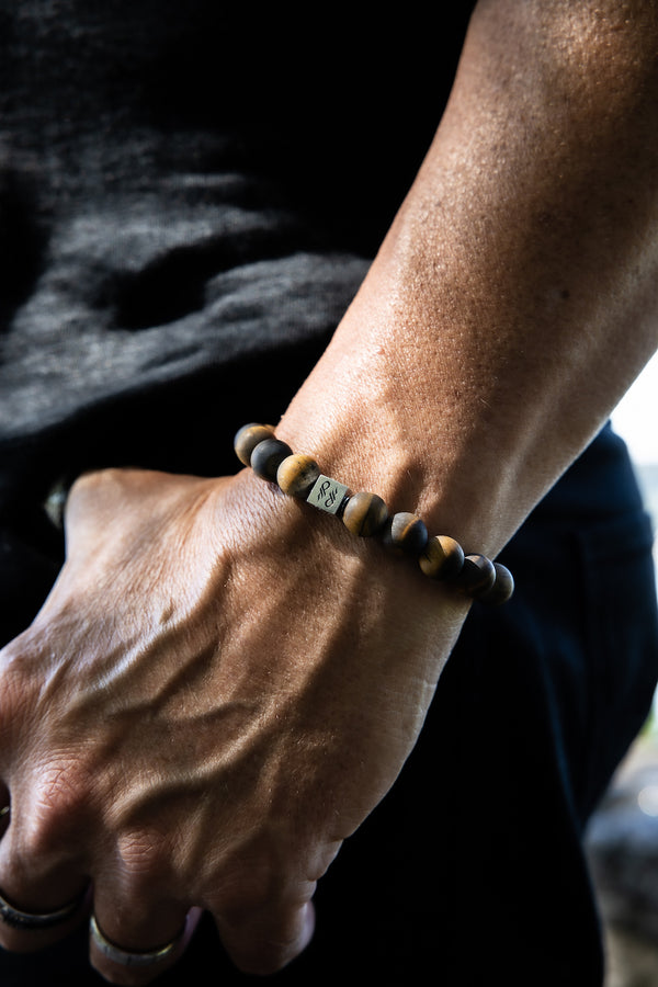 Man wearing Tigers Eye Matte Gemstone Centerpiece Bracelet