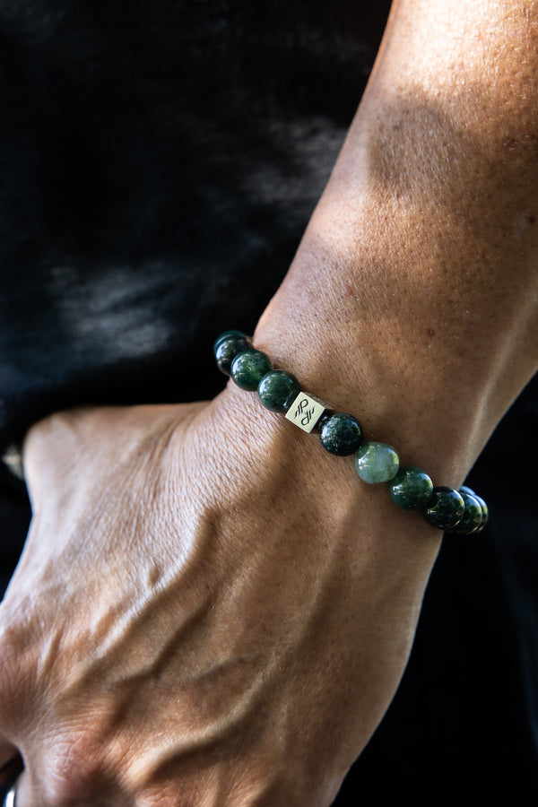 Male wearing Moss Agate Natural Gemstone Bracelet.
