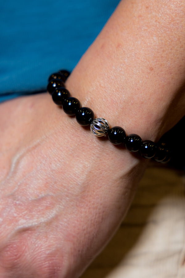 Man wearing Onyx Abacus Gemstone Bracelet.