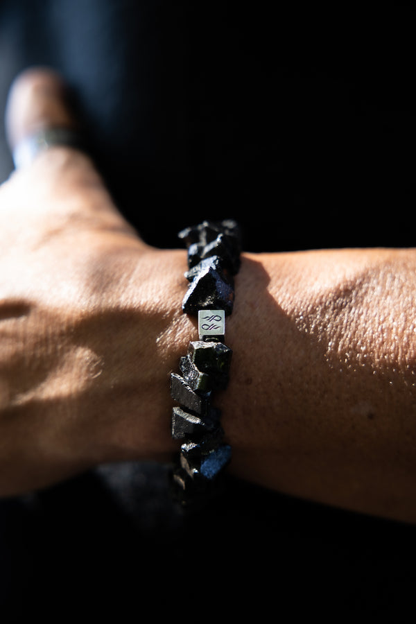 Alt= Male wearing Raw Black Tourmaline Natural Gemstone Braccelet.