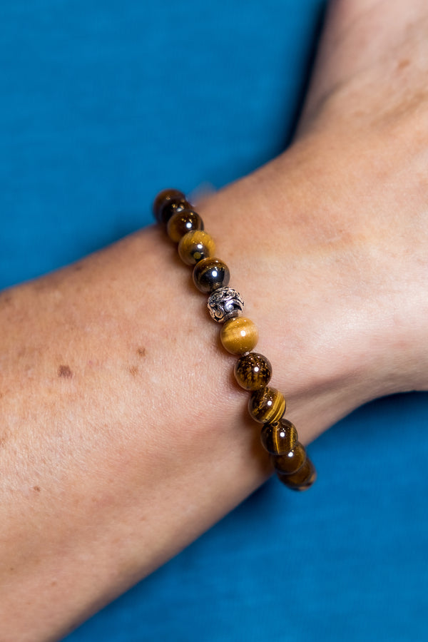Man wearing Tigers Eye Balinese Bracelet.