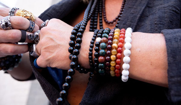 male wearing natural stone bracelets