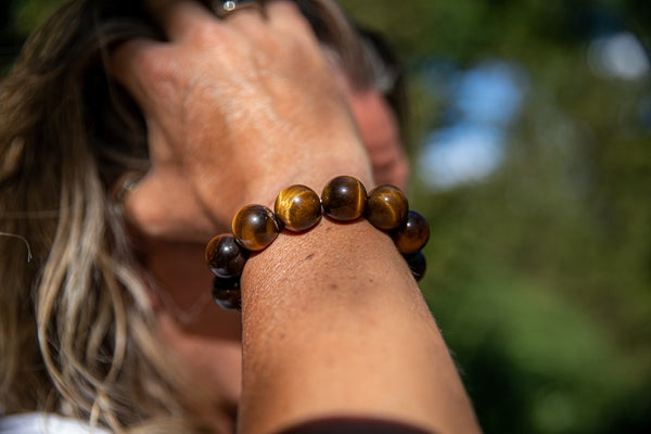 Alt= Male Model Wearing Tigers Eye Natural Gemstone Bracelet