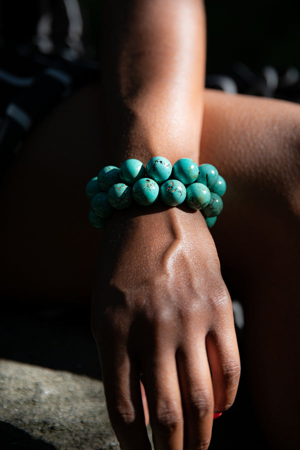 Alt= Female Model wearing Tibetan Turquoise Gemstone Bracelets.