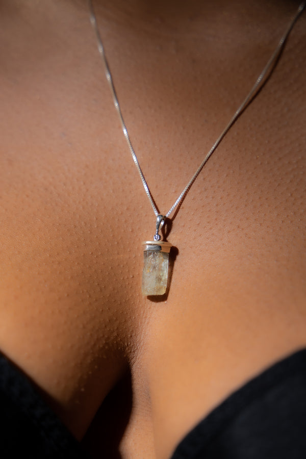 Hiddenite Gemstone Necklace on Woman.