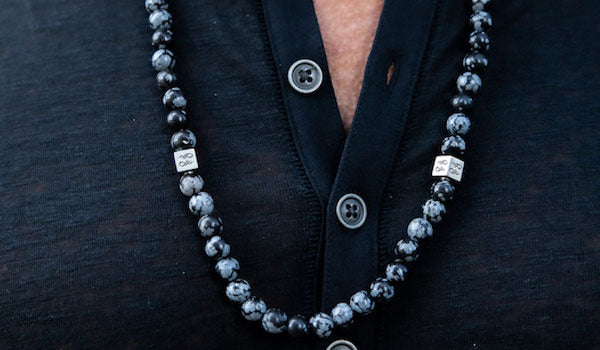 Alt= Male wearing Snowflake Obsidian Gemstone Necklace