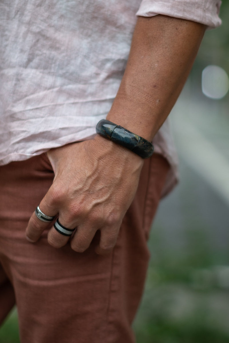 Alt= Male model wearing blue tigers eye flagstone bracelet.