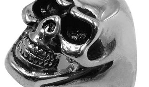 silver skull ring close up