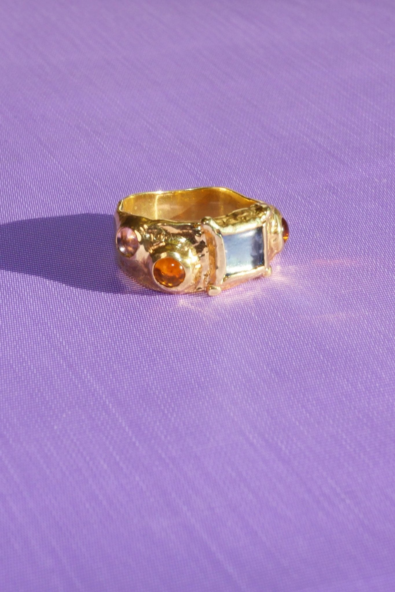 SUEDE RING WITH BLUE, ORANGE AND PINK GLASS