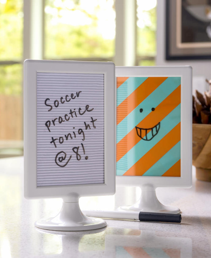 Make your own dry erase board the easy way! This DIY dry erase board was created from a $1 frame and uses washi tape