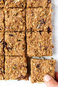 These healthy zucchini breakfast bars are the ultimate morning treat! Made with oats, quinoa, banana, and zucchini, they're healthy, vegan & gluten-free!