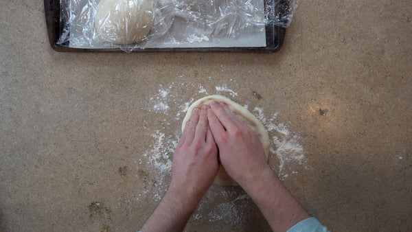 Shaping your homemade pizza dough