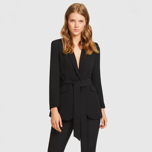 Woman in Black Aris Suit