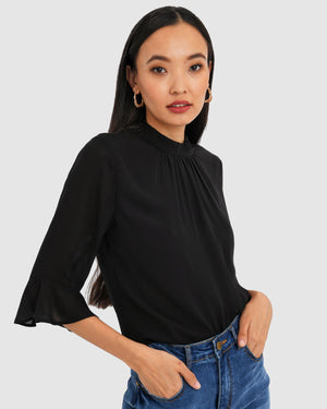 Black Elisse Ruffle Sleeve Top by Forcast