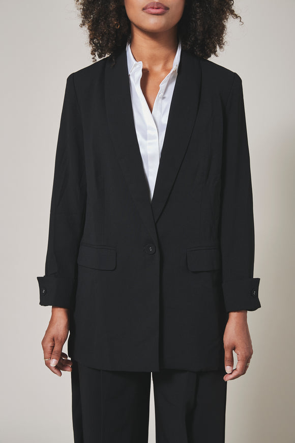 Black, loose-fitted blazer with one front button and cuffed sleeve. front view
