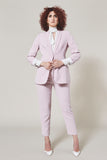 Light pink cigarette pants. Full body shot of model also wearing matching Rosé Blazer and white button down.