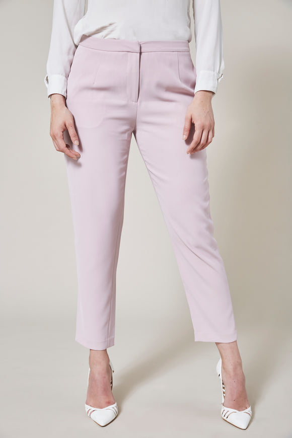 Light pink cigarette pants. Model facing forward.