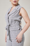Slate grey plaid suit vest with two pockets, one black button and waist tie