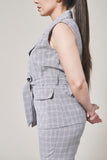 Slate grey plaid suit vest with two pockets, one black button and waist tie. Side view.