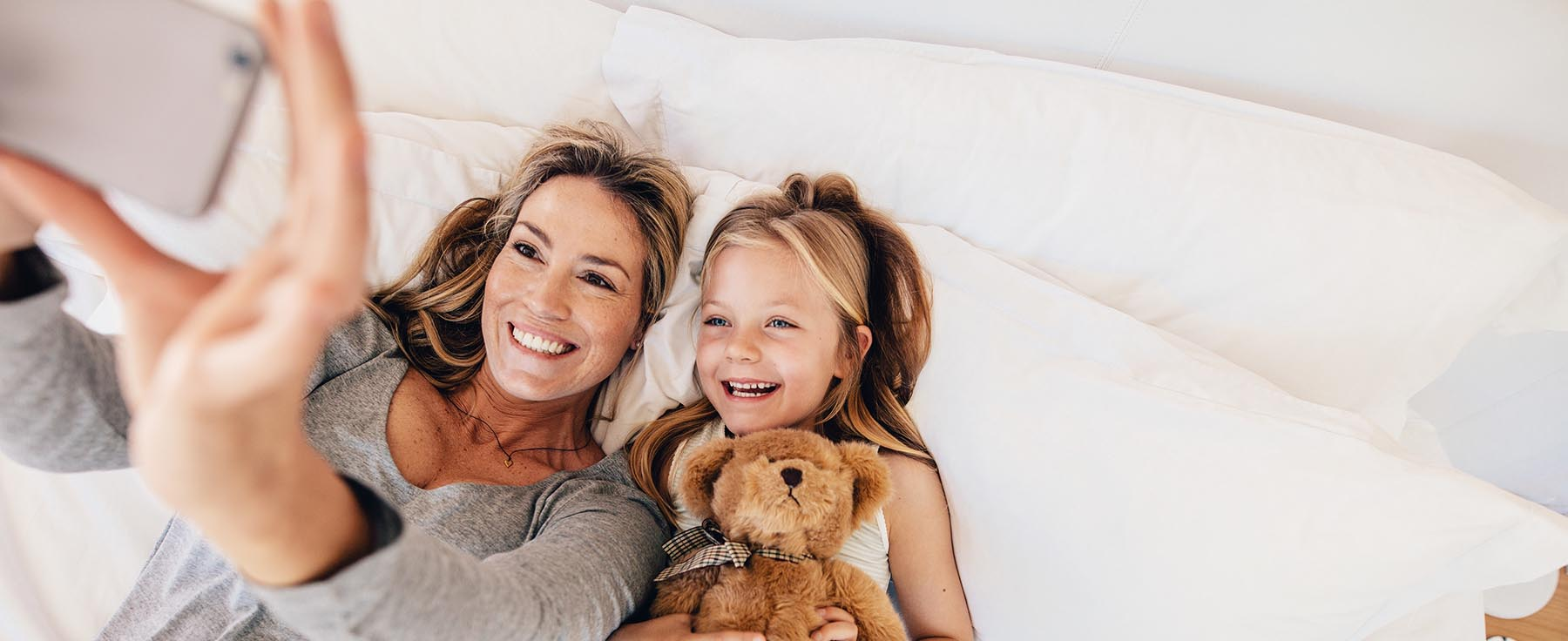 Mum taking photo with her daughter | The Companionist