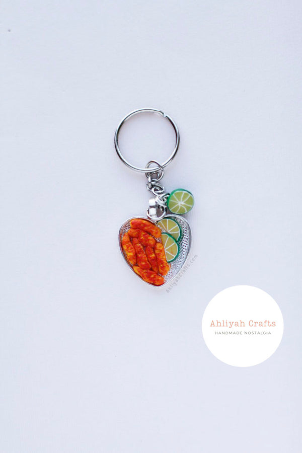 Silver Heart shaped keychain with miniature hot cheetos and two lime slices. Half a lime charm attached to keychain.